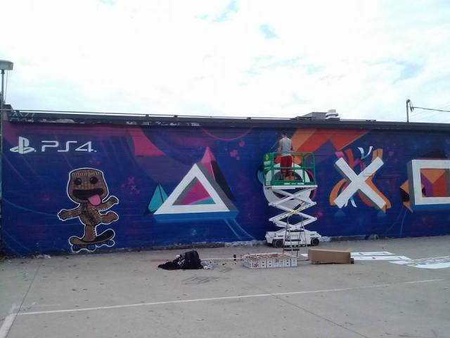 An artist was painting this mural during the day's events.